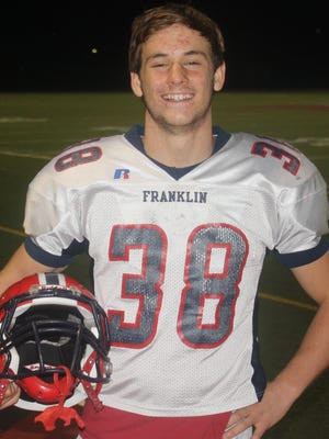 Livonia Franklin junior Chris Nehasil is a two-way starter for the surging Patriots. His game jersey is No. 40, which pays tribute to his late uncle Larry Nehasil, a Livonia police officer who was killed in the line of duty in 2011.