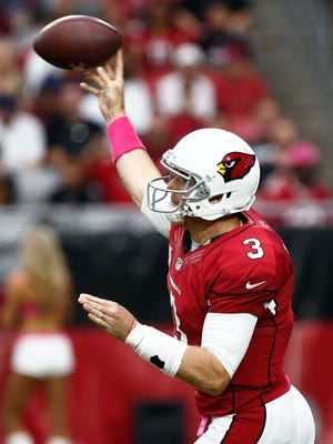Cardinals quarterback Carson Palmer, shown in an Oct. 12 win over the Redskins, has been spreading the ball around the past two weeks. And his wide receivers aren't complaining.