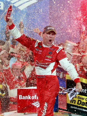 Kevin Harvick celebrates in victory lane after winning the Bank of America 500 at Charlotte Motor Speedway.