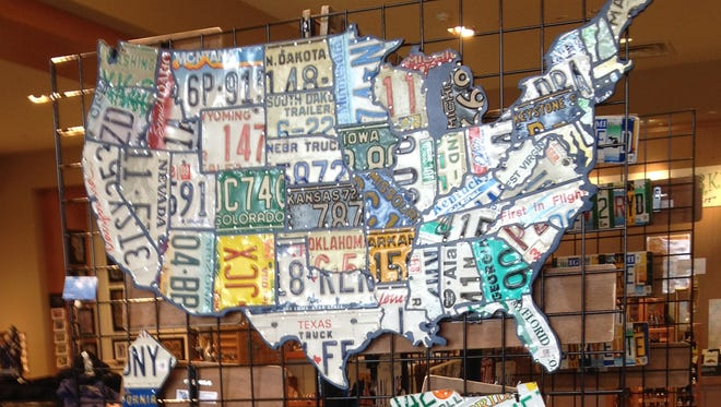 Artwork created from license plates, including this U.S. map, is at the Art Is In Market at Laurel Park Place in Livonia.