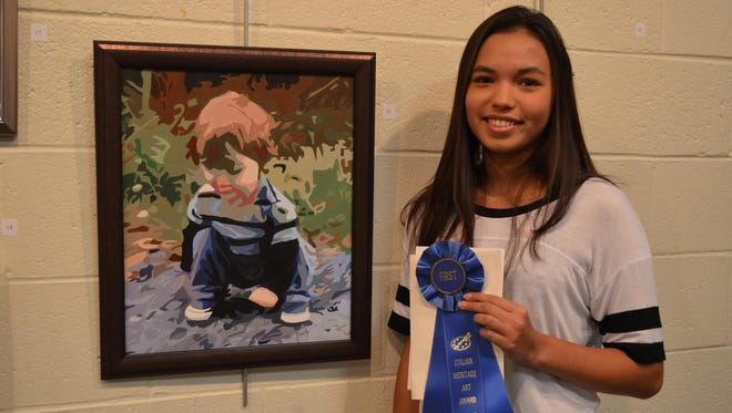 """Laurianna Panico, 16, of Mullica Township, a student at Clearview Regional High School, won Best of Show with her acrylic entry """"Baby Cole."""""""