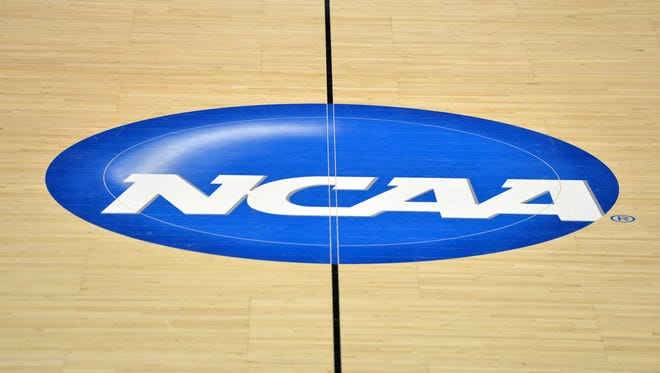 General view of the NCAA logo at midcourt.