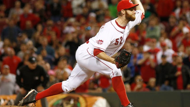 May 13, 2015; Cincinnati, OH, USA; Cincinnati Reds relief pitcher Tony Cingrani (52) throws against the Atlanta Braves in the ninth inning at Great American Ball Park. The Reds won 5-1. Mandatory Credit: David Kohl-USA TODAY Sports
