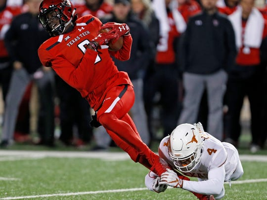 Texas Tech's T.J. Vasher (9) is tackled by Texas' Anthony Cook (4) during the second half Nov. 10 in Lubbock, Texas.  (AP Photo/Brad Tollefson)