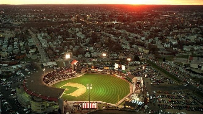 Pawtucket's McCoy Stadium is crowned by the setting sun in 2000.