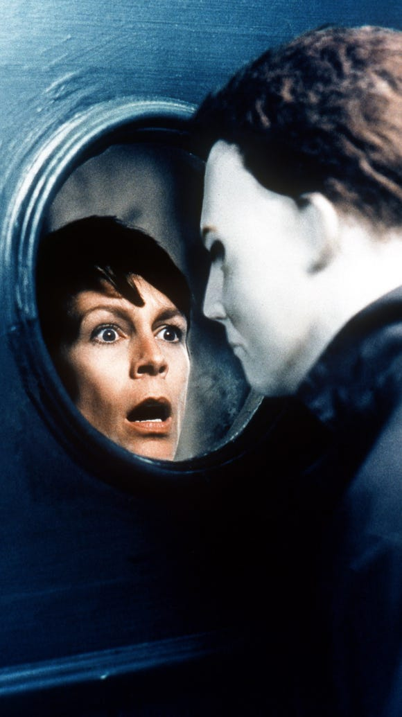 Jamie Lee Curtis and the character Michael Myers in