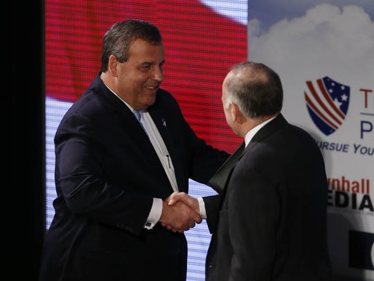 New Jersey Gov. Chris Christie shakes hands with Congressman