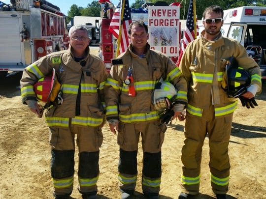 (Left to right): Steve Murphy, Dwayne Murphy and Kendall Murphy. Three generations of firefighters.
