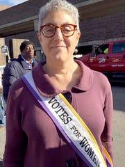 Arlene Frank, 61, of Detroit wore her suffragette sash