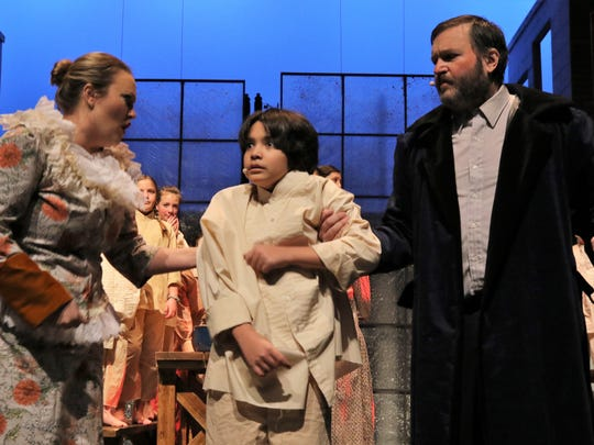 "Sarah Cole Liese, left, Ryan Frick and Eric Liese are featured in the San Juan College production of ""Oliver!"" opening this weekend."
