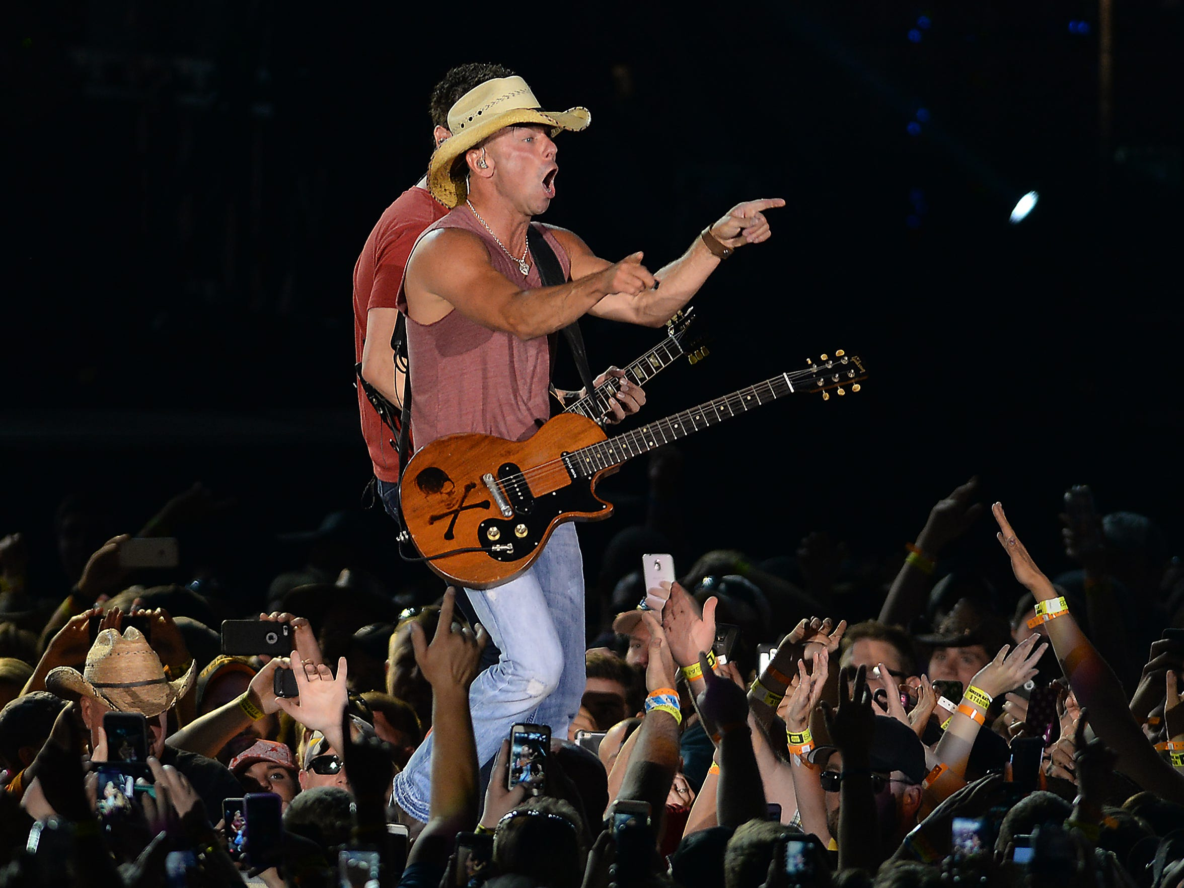 Kenny Chesney performs to more than 50,000 fans at Lambeau Field in June.