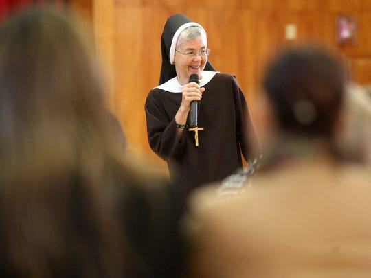 """Sister Marilyn Minter speaks to parishioners from throughout the Diocese of Metuchen prior to a walk-a-thon entitled """"Going the Extra Mile for Kids in Need of Jesus"""", Sunday, October 18, 2015, as part of World Mission Sunday in Metuchen, NJ."""