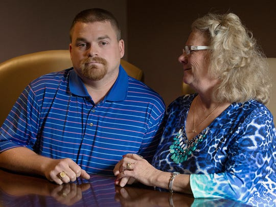 From left, Matthew Hoagland, 33, and mother Linda Iseler pose for a portrait in Fort Wayne, Ind., Thursday, July 28, 2016. Iseler's ex-husband Richard Hoagland left her and their family unexpectedly in 1993, and was recently found to be living in Florida under the stolen identity of a dead man. Iseler said Matthew has been her rock throughout the experience.