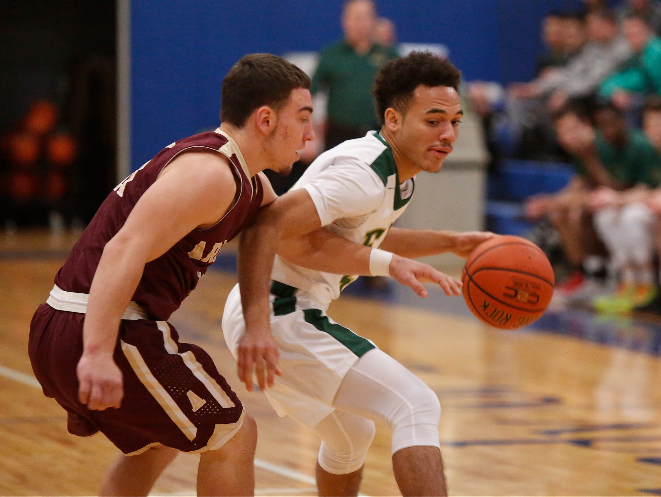 Arlington's Zac Dingee guards a Franklin D. Roosevelt player during a game in the Duane Davis Memorial Tournament on Dec. 31.