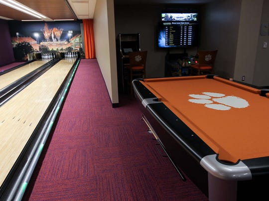 A two-lane bowling alley and pool tables are among the features inside the players' lounge at Clemson's Allen N. Reeves Football Complex.