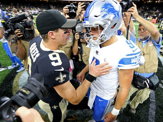 Oct 15, 2017; New Orleans, LA, USA; Saints quarterback Drew Brees talks to Lions quarterback Matthew Stafford, after the Saints won, 52-38, at the Mercedes-Benz Superdome.