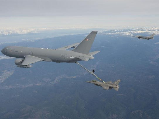 A KC-46 (left) fuels an aircraft on a test mission.