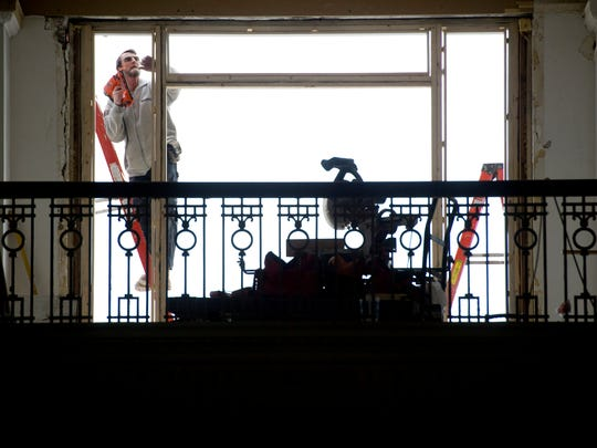 Tom Shearer frames a door on the second floor of the McCurdy Tuesday afternoon. The door will open up to a balcony for residents.