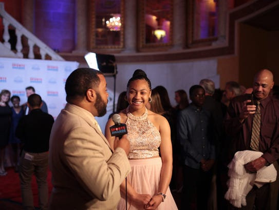 Free Press Sports producer Kirkland Crawford talks with bowler Cheyenne Washington of Lake Orion High School during the Sports Awards on Friday at The Fillmore Detroit.