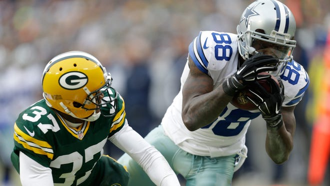 Dallas Cowboys wideout Dez Bryant tries to haul in a pass against the Green Bay Packers on Sunday. It was originally called a catch, but was overturned after a replay.