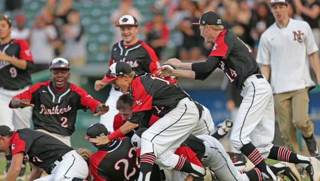 North Central baseball players celebrate after defeating Brebeuf during  the 2016 Marion County Tournament at Victory Field, Friday May 13th, 2016. North Central won 6-4.