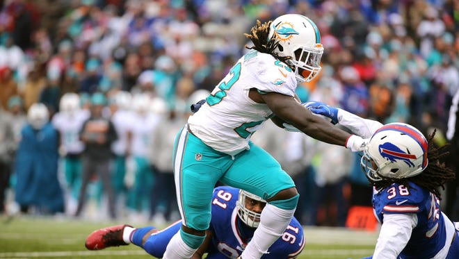 Miami running back Jay Ajayi breaks 2 tackles and runs for a touchdown.