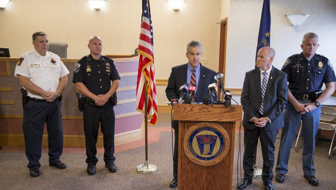 Law enforcement personnel speak about the arrest of Buster Hernandez, of Bakersfield, Calif., who is charged with a variety of cyber crimes, including threats in Plainfield during 2015 and 2016, Plainfield, Monday, August 7, 2017.