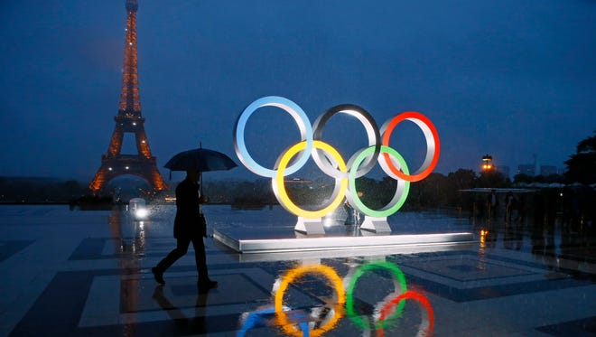 A display of the Olympic rings is set up on Trocadero plaza that overlooks the Eiffel Tower after the vote in Peru awarding the 2024 Games to the French capital.