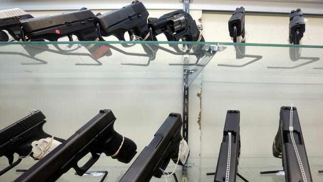 This Wednesday, June 29, 2016, photo shows guns on display at a gun store in Miami. After a gunman killed more than 50 people in Las Vegas in the nation's latest mass shooting, stocks in the gun industry rose, Monday, Oct. 2, 2017.