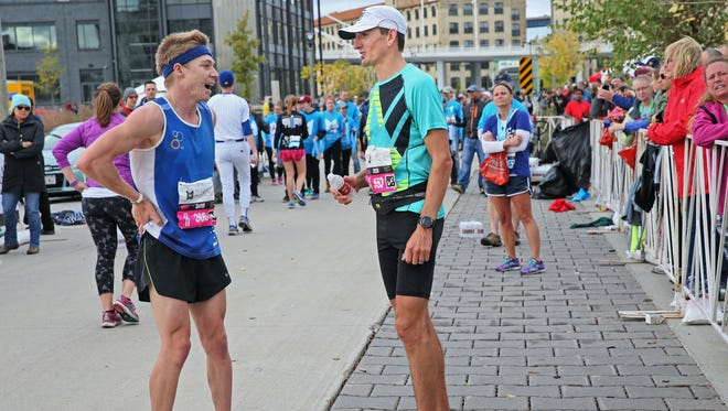 PNC Milwaukee Marathon winner Tyler Sigl of Seymour (right) compares notes with second-place finisher David Luy of Brookfield. Unofficial times were 2:20 for Sigl and 2:23 for Luy.