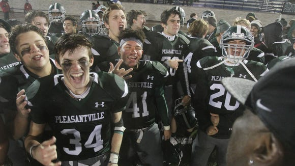 Pleasantville players celebrate their 20-7 victory