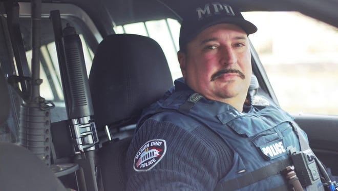 Tony Pahl, who has been a patrol officer in Marion for almost 28 years, sits in his police cruiser during a shift Tuesday Afternoon. City Council approved contracts with the Fraternal Order of Police that will give officers a 2.5 percent wage increase every year of the three year contract.