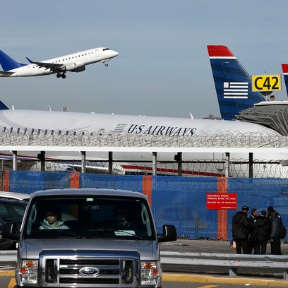 A plane takes off from LaGuardia Airport in New York