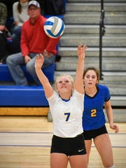 St. Cloud Cathedral's Abbey Medelberg passes the ball earlier this season against Albany.