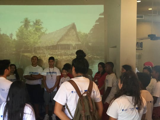 Ta Fan Apatte student presentations open with a chant at the PEIAM Museum in Long Beach.