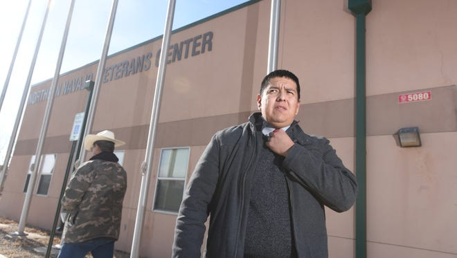 Robertson Yazzie Jr., right, stands next to the Northern Navajo Veterans Center on Dec. 29 in Shiprock.