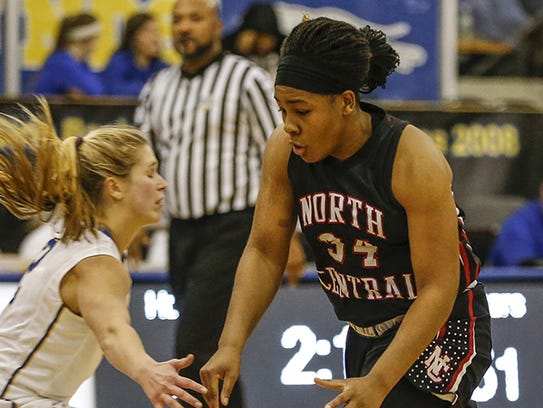 North Central Panthers' Ajanae´ Thomas (34) slips past