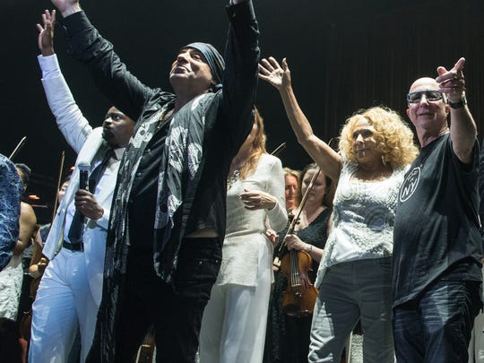 Steven Van Zandt, Darlene Love and Paul Shaffer thank the audience after the concert at the Paramount Theater in Asbury Park, NJ, on Saturday, September 12, 2015.