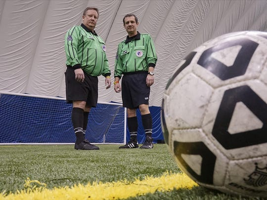 As much as Kevin Winningham (left) and Mario D'Agostino love calling soccer games at High Velocity Sports in Canton and at other area venues, their patience is being tested by parents and others who jump at any chance to criticize dedicated refs.