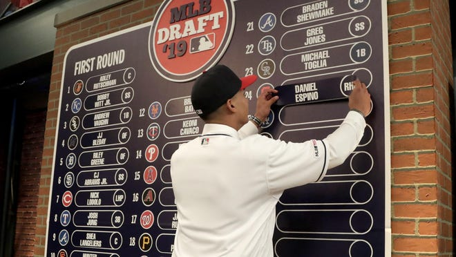 Daniel Espino, a right-handed pitcher from Georgia Premier Academy in Statesboro, Ga., places his name on the draft board after being selected No. 24 by the Indians in the first round of the draft last June.
