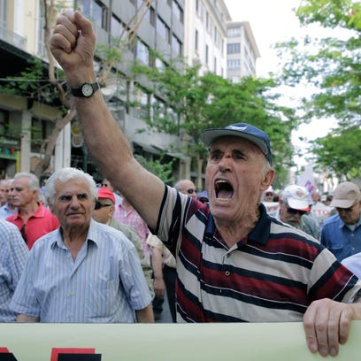 Pensioners chant anti-austerity slogans during a protest
