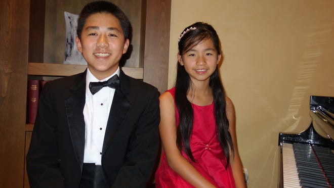 From left: Steinway competition winners Andrew Tang and Catherine Duan.