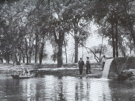"""A quiet, hot day in Mooney Park in 1924 shows an undeveloped shoreline of the lagoon. This is one of many historical photos published in William Allen's """"Mooney's Oak Grove."""""""