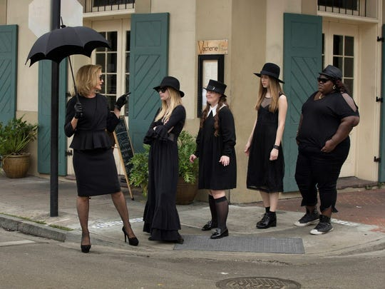 "Modern-day witches reimagined in the television series ""American Horror Story: Coven."" Pictured are actors Jessica Lange, Emma Roberts, Jamie Brewer, Taissa Farmiga and Gabourey Sidibe."