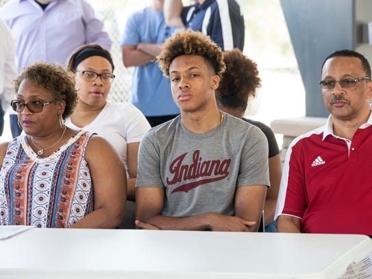 Romeo Langford sat flanked by family during a groundbreaking