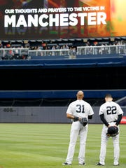 New York Yankees outfielders Aaron Hicks (31), Jacoby Ellsbury,(22) stand at attention as the British National Anthem is played prior to a baseball game against the Kansas City Royals at Yankee Stadium in New York, Tuesday, May 23, 2017 in memory of victims of the Manchester, England bombing.