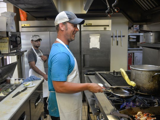 Kay's Kitchen Chef Dan Kuebelbeck flips an omelette Friday, July 22, 2016, at the restaurant in St. Joseph. The restaurant is known for its breakfasts, served all day, as well as its burgers and pies.