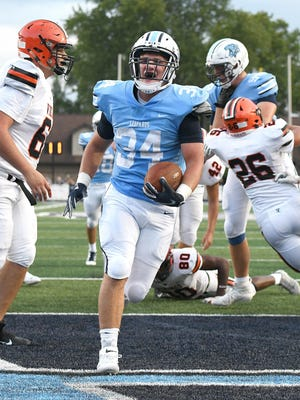 Louisville running back Connor Adelman scores his second touchdown in the first quarter against Hoover, Sep. 6, 2019.