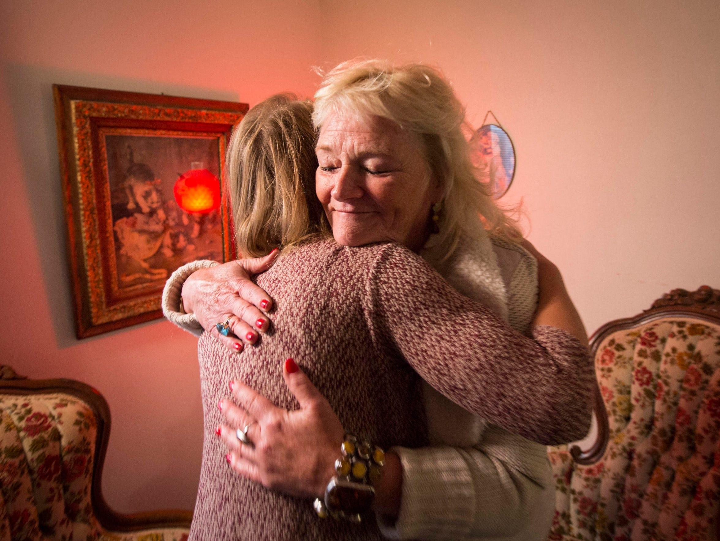 Medium Janine Ambrose gives a hug to Kristi Beyer of