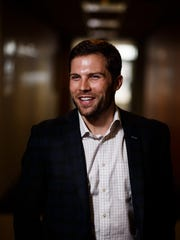 """Reed McManigal is an account executive at Holmes Murphy in West Des Moines. """"The people, the clients and the culture,"""" are what McManigal, a former lawyer, said he enjoys the most. Iowa insurance companies strive to recruit millennials."""